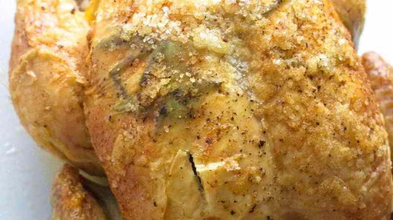This deliciously succulent roast chicken is flavoured with rosemary, lemon and garlic. Rub the skin with butter and salt to get it extra crispy!