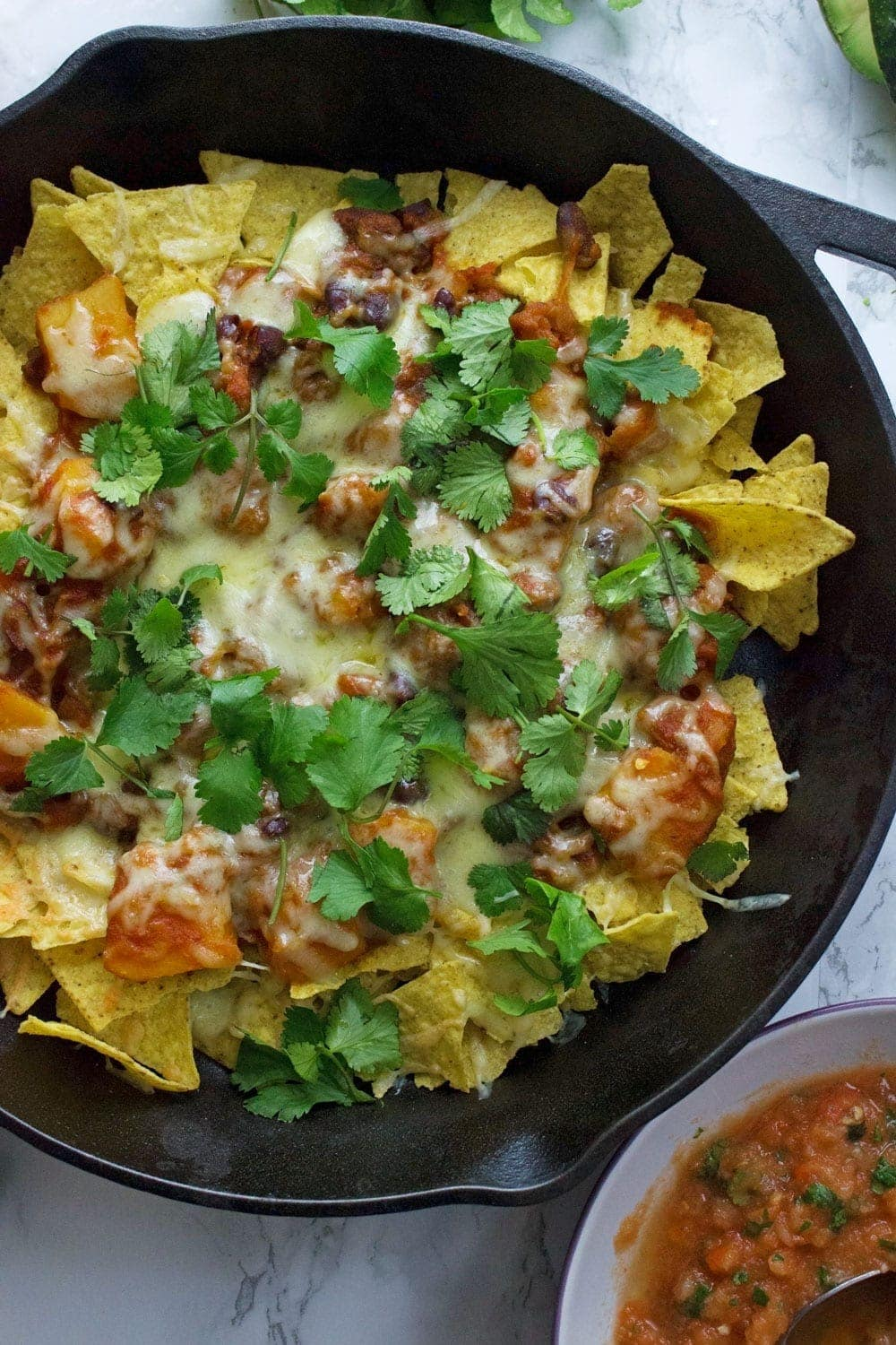 This healthy butternut squash chilli makes the perfect topping for these vegetarian nachos. Add all your favourite toppings for a delicious twist on a classic!