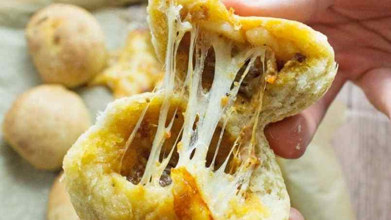 These pesto mozzarella stuffed dough balls make a perfect appetiser. These cheesy dough balls are so easy to make and would be great for a party!