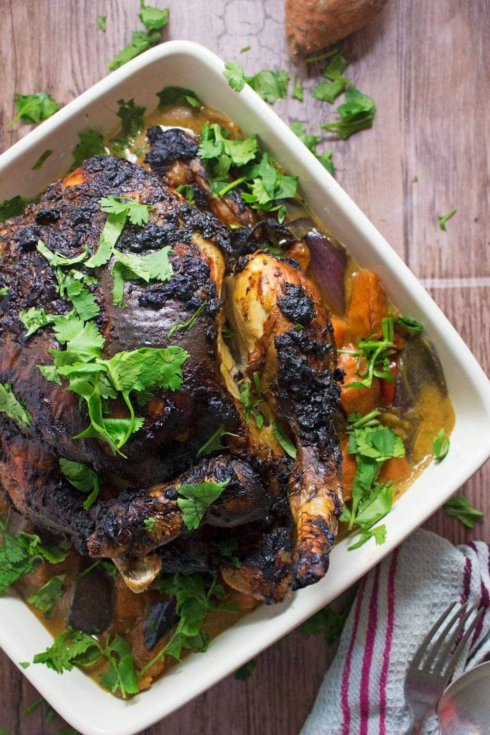 This jerk roasted chicken is coated in jerk spice paste before roasting over chopped vegetables. Serve with a rich and tasty curry sauce made with the cooking juices!