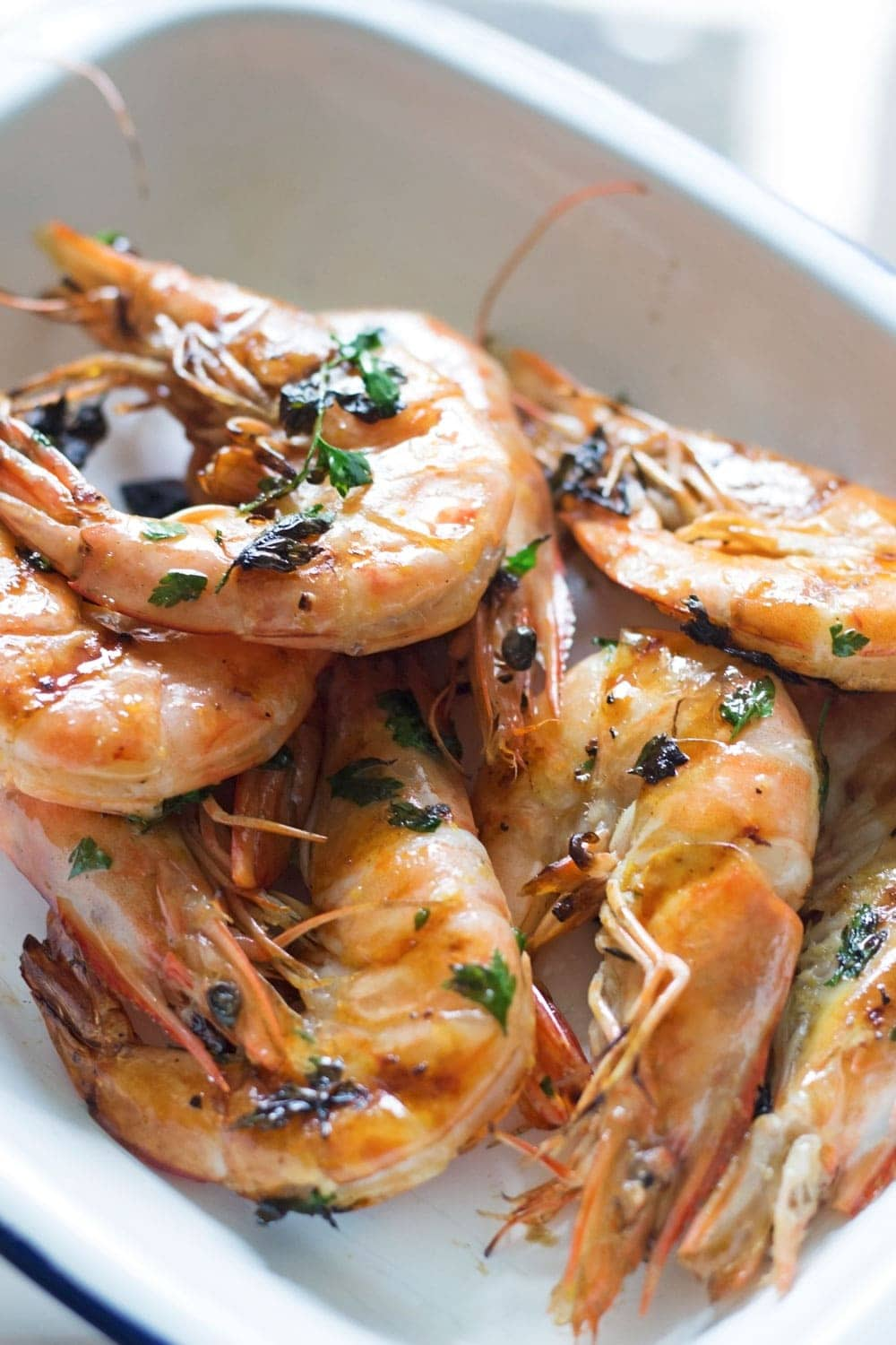 This chilli & garlic prawns recipe is the perfect thing to serve at a summer dinner party! It's quick, simple and is guaranteed to impress.