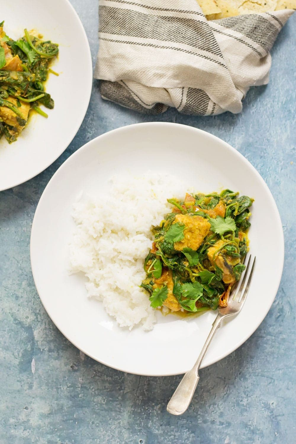 Salmon and tomato curry is a tasty change from a traditional curry recipe. Not only that but the spinach, tomato and salmon make it a healthier option too!