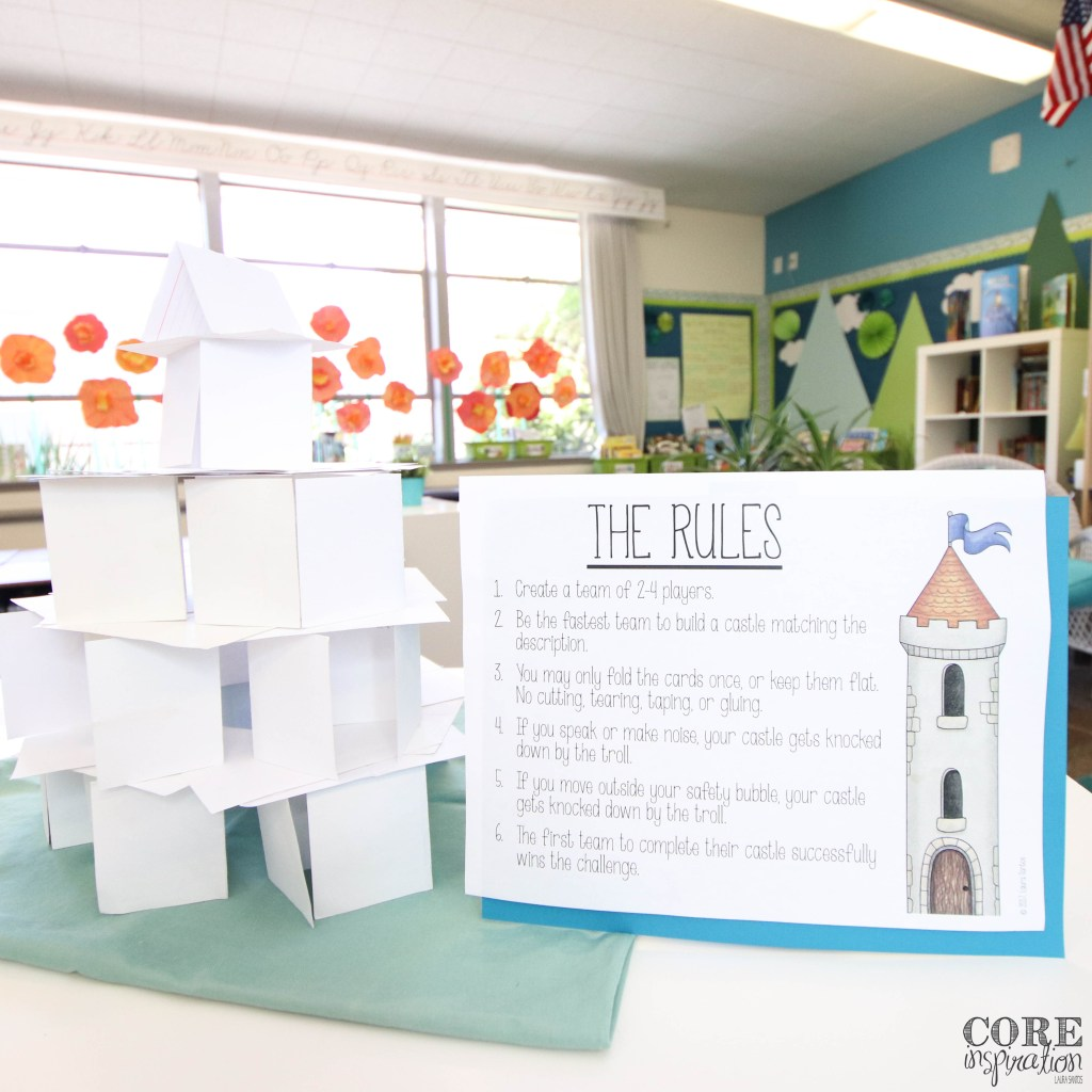 Rules of Index Cards and Castles on display next to a castle made of index cards.