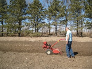 John tilling the soil