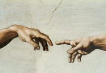 Hand of God and Adam in Sistine Chapel