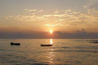 Fishing boats in the ocean near Cabuya at dawn.
