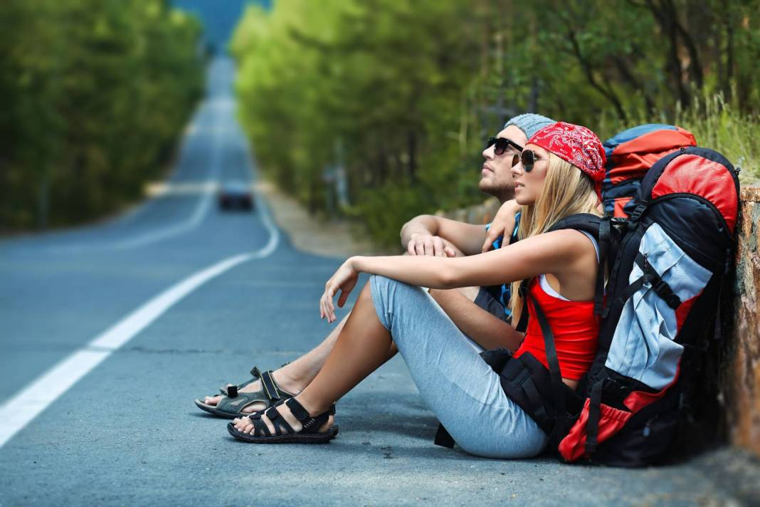 Backpackers resting on the road