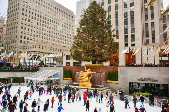 The Christmas tree in front of the Rockefeller Center Tower is an iconic tradition in New York City.