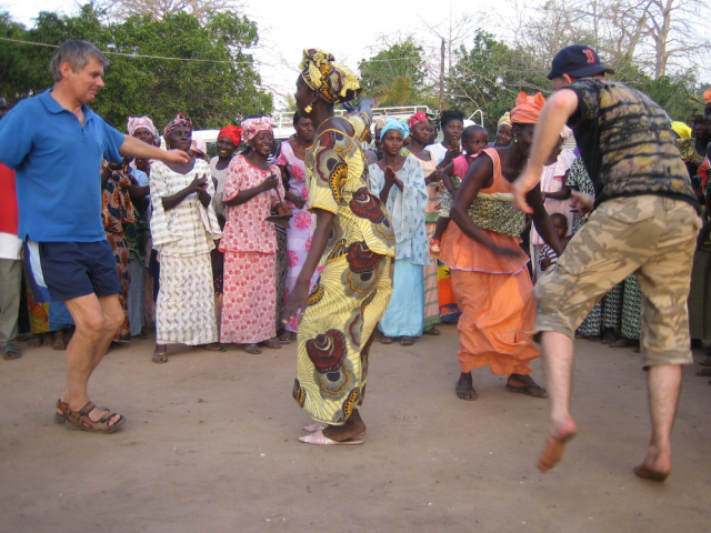Tourists dancing an ethnic dance in Africa.