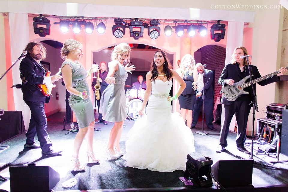 bride and bridesmaids singing on stage