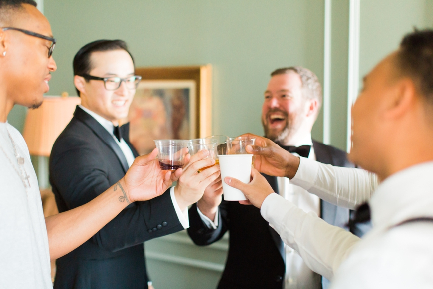 groom and groomsmen cheer