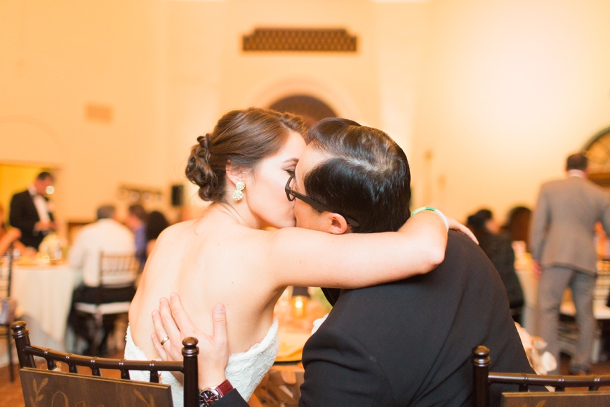 bride groom kissing during reception parador