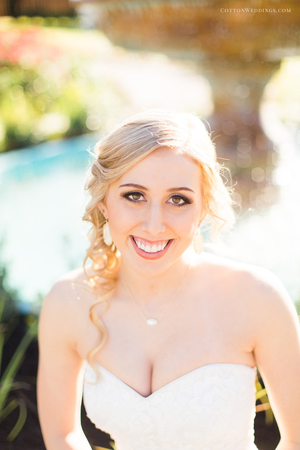 beautiful blonde bride by fountain