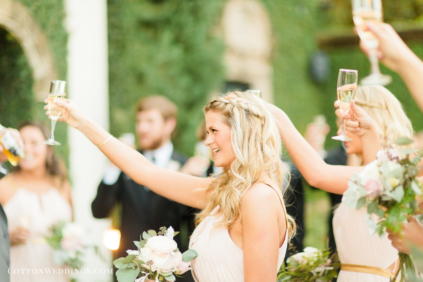 bridesmaids cheers with champagne after ceremony