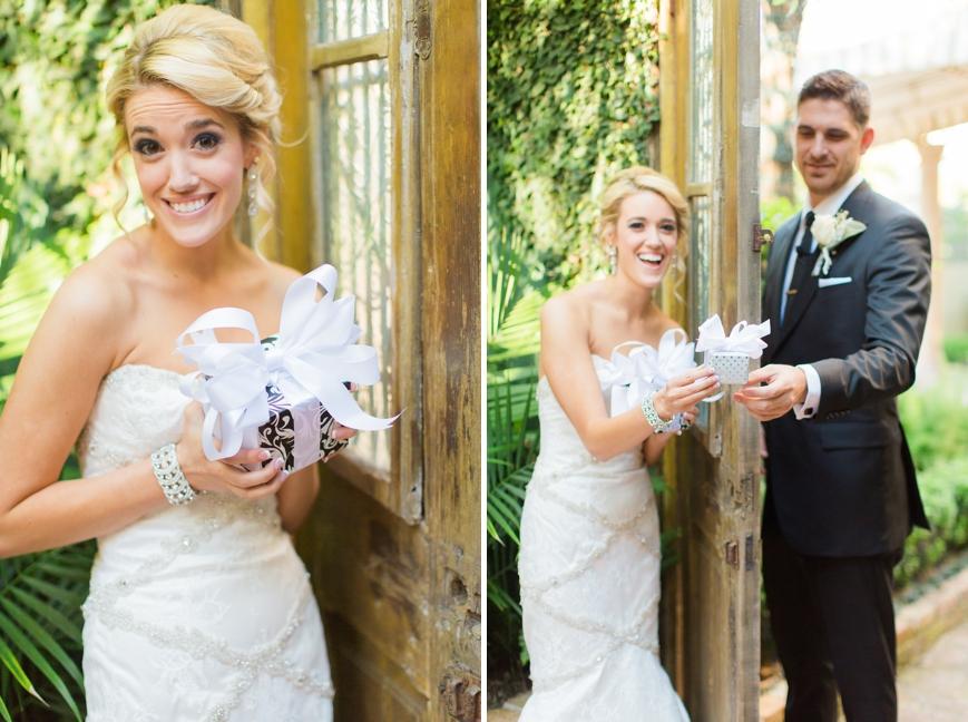 bride and groom exchange gifts across a door