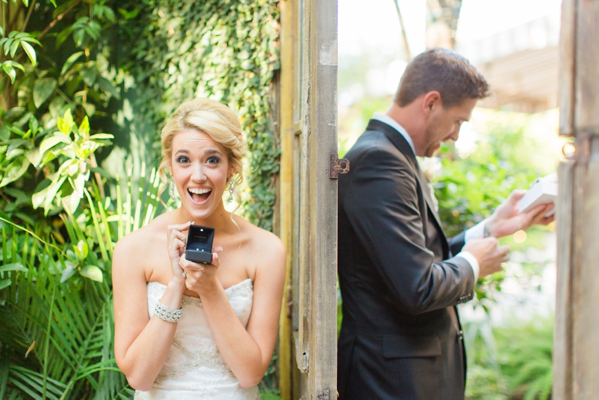 excited bride with diamond earrings gift from groom