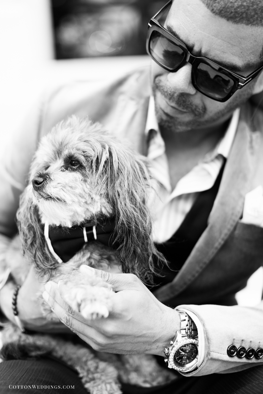 black and white portrait of man with schnoodle dog