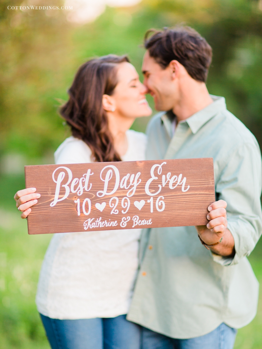 cute couple kissing with best day ever custom save the date sign