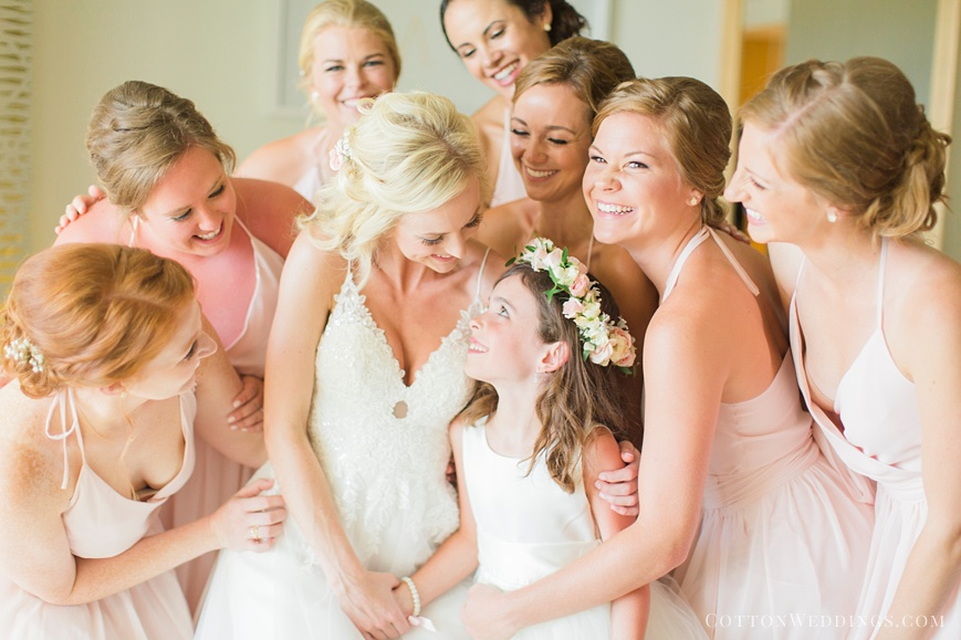 adorable photo of bride hugging flowergirl and bridesmaids