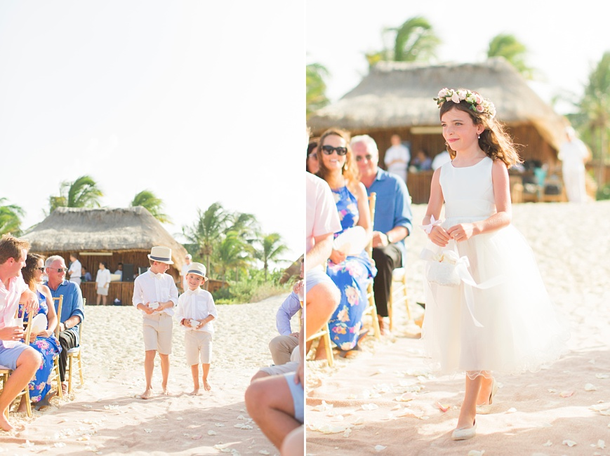ring bearers and flower girl walking down the aisle at beach wedding