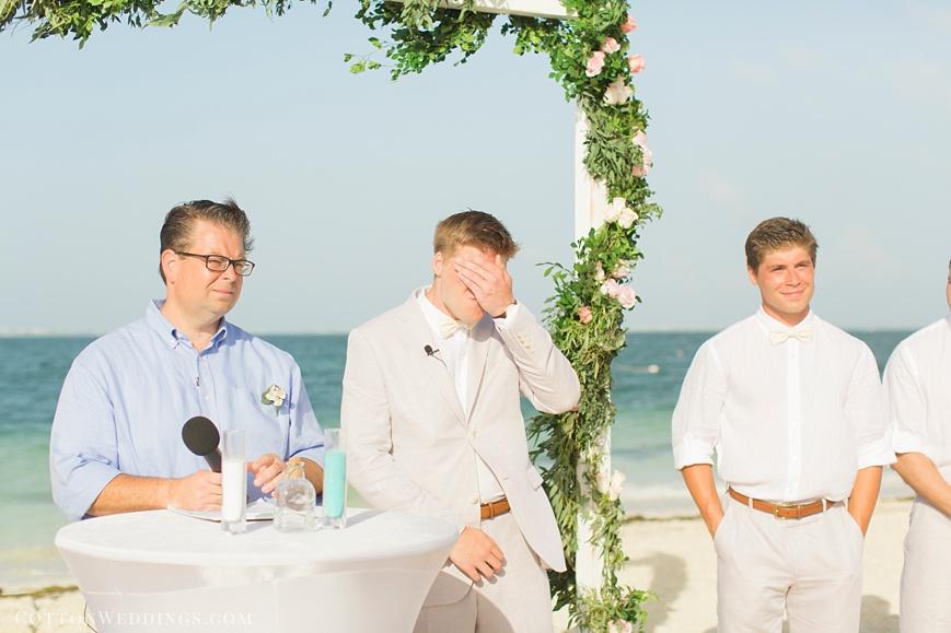 groom crying beach wedding