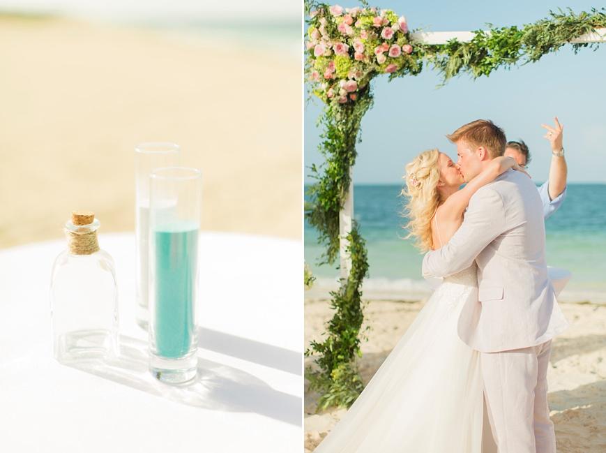 first kiss during destination beach wedding
