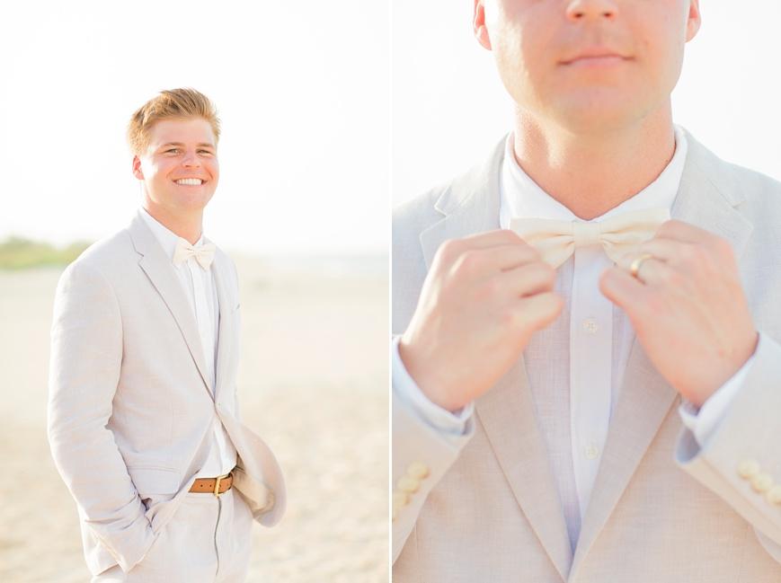 portrait of groom in tan suit beach wedding