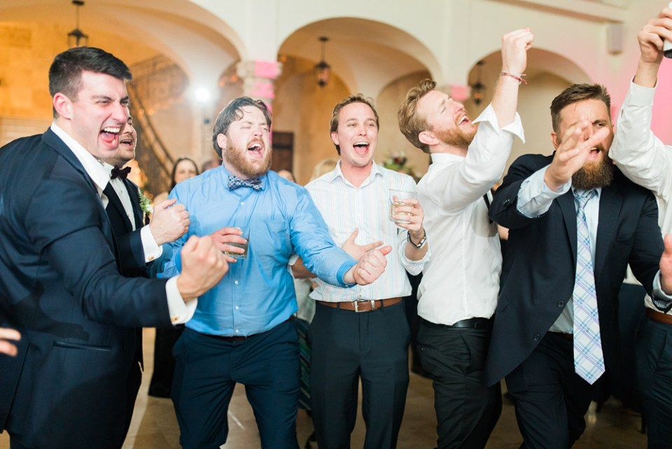 groom party dancing at wedding reception