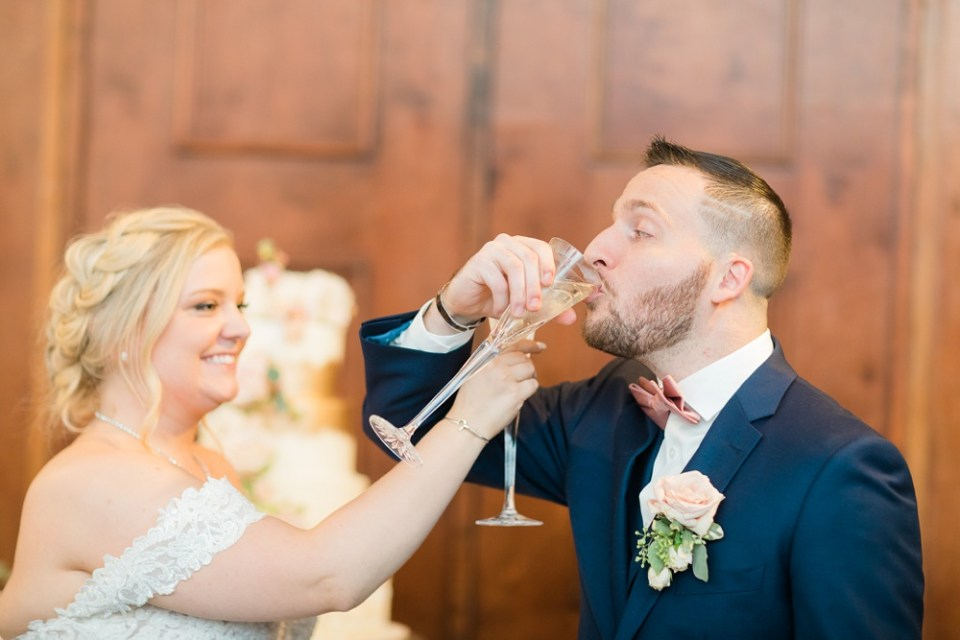 bride and groom toast at wedding