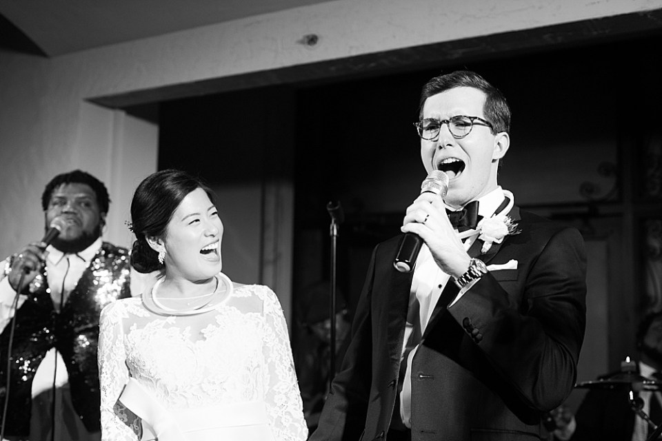 groom singing to bride at the bell tower
