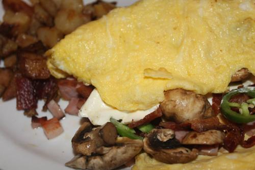 Bacon, jalapeño, cream cheese, mushroom, and ham. In a wonderful BYO Omelette
