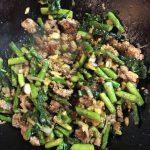 Pork and asparagus stir fry close up in wok