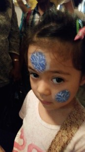 Snowflakes peppering a little girl's face