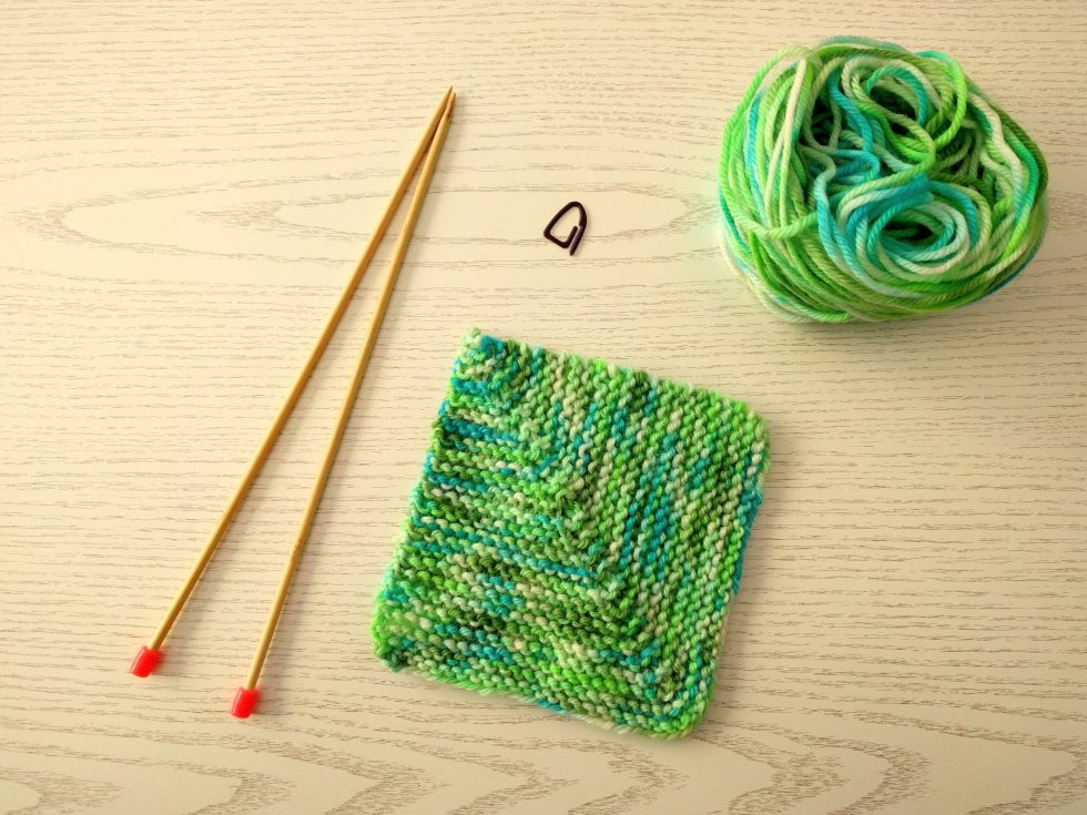 mitred square knitting with knitting needles and yarn