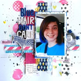 AmberPageScraps: I love Missy Widden's style! I just straight lifted her layout! My daughter got some punk rock blue in her hair this summer, and I felt like Missy's layout would work perfectly for this picture.