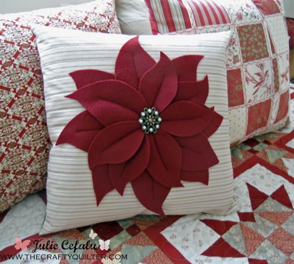 poinsettia pillow on bed 3 copy