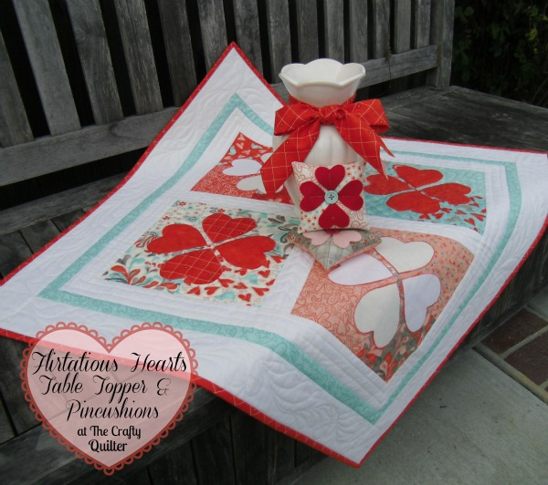 Quilted heart projects @ The Crafty Quilter includes this Flirtatious Hearts Table Topper for the Moda Bake Shop