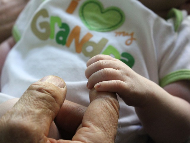 Grandpa's Finger in the palm of my hand, photography by Julie Cefalu