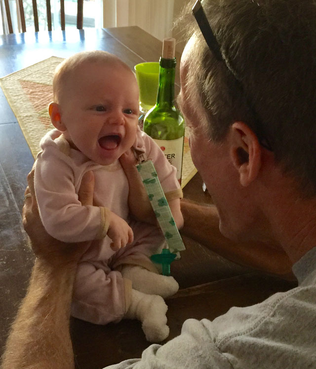 amelia smiling at grandpa