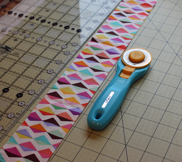 My Olfa Splash rotary cutter is one of the five favorite quilting tools I love.