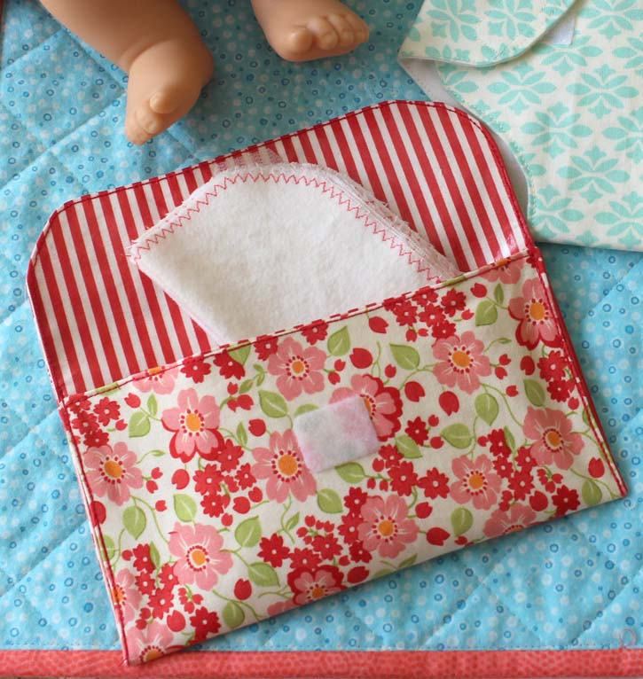 This doll wipes and pouch tutorial is easy to make and uses iron-on vinyl to make a waterproof pouch for baby doll wipes.  Full tutorial @ The Crafty Quilter.