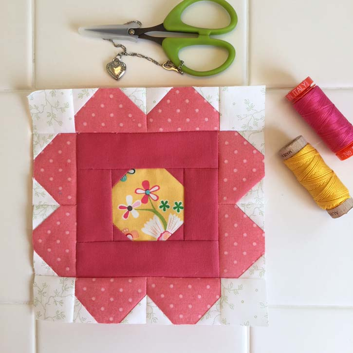 The Patchsmith's Sampler Block, Field Rose, made by Julie Cefalu. Designed by Amanda Weatherill