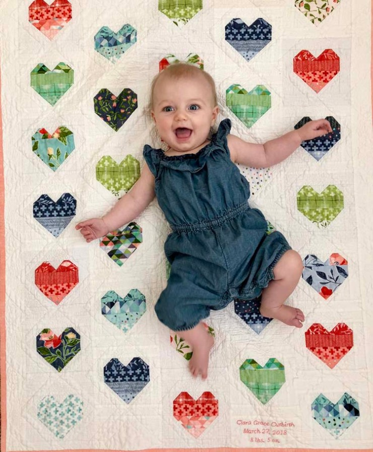 Baby Clara at 4 months old on her heart quilt by @ The Crafty Quilter