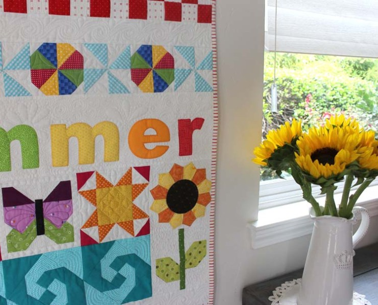 This Summer Fun Wall Hanging is a free tutorial @ The Crafty Quilter.  Free Motion quilting is added to complete this vibrant quilt.