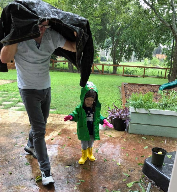 Amelia, 3 years old, playing in the rain with Grandpa, via The Crafty Quilter