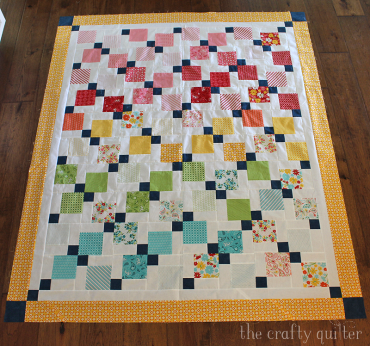 Disappearing 9-patch quilt made by Julie Cefalu @ The Crafty Quilter.  Check out the quilt along details for free instructions!