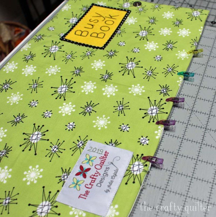 Busy Book made by Julie Cefalu @ The Crafty Quilter.  Showing detail of the outer cover reading for top stitching.