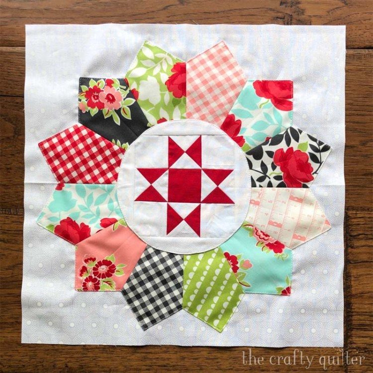 Ohio Star quilt block is nestled inside a Dresden Plate for the Plain & Fancy quilt, designed by Corey Yoder of Coriander Quilts.  This block was made by Julie Cefalu @ The Crafty Quilter