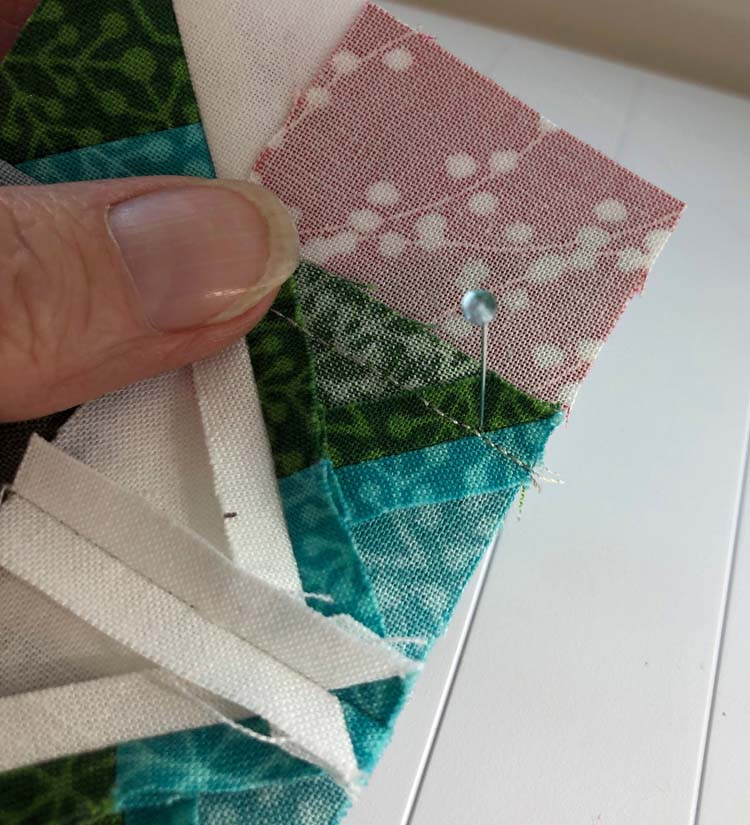 A Setting pin helps to match diagonal seam allowances - The Crafty Quilter