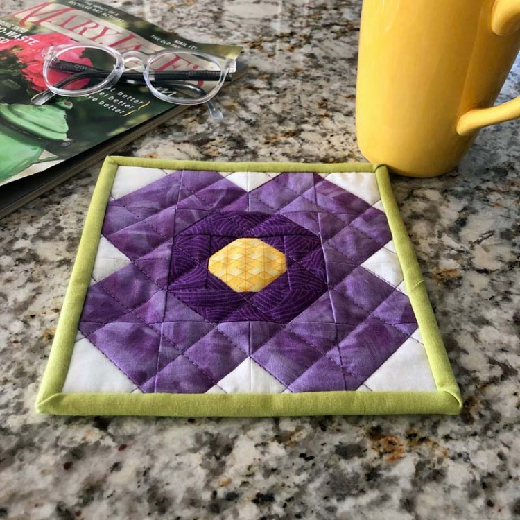 Blossom Mug Rug made and designed by Julie Cefalu @ The Crafty Quilter using her free Blossom Quilt Block tutorial.